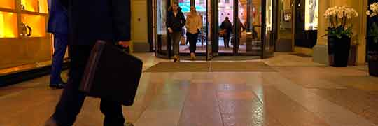 Clients Entering Store Through Revolving Door